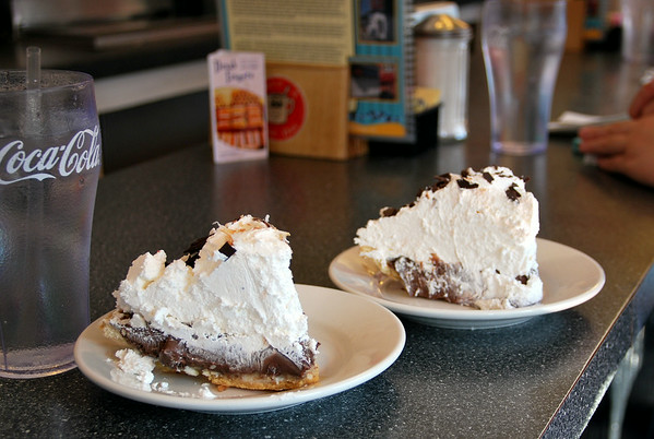To the left - cocoa-nut cream pie; to the right - chocolate cream pie.
