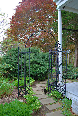 Nathaniel and the side porch garden gate