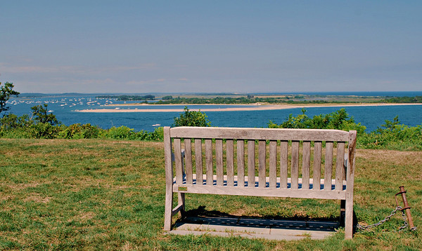 Bench overlooking the ocean at the top of the Grande Allée